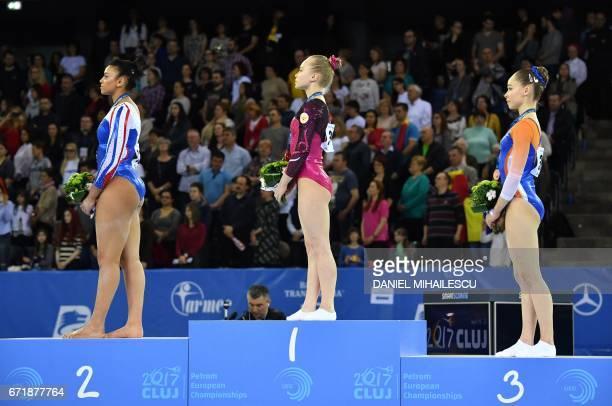 Silver winner Elissa Downie of Great Britain Gold winner Angelina Melnikova of Russia and Bronze winner Eythora Thorsdottir of The Nederlands during...