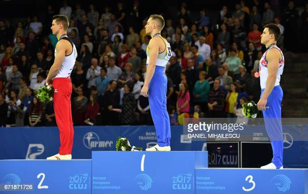 Silver winner Lukas Dauser of Germany Gold medalist Oleg Verniaev of Ukraine and Bronze winner Nikita Nagornyy of Russia during the medals ceremony...
