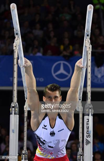 Silver winner Lukas Dauser of Germany performs on parallel bars of apparatus final for the European Artistic Gymnastics Championship in Cluj Napoca...
