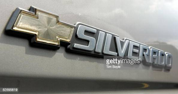 Silverado logo is displayed on a 2005 Chevrolet Silverado pickup truck at a new car lot April 6 2005 in Elk Grove Village Illinois The National...