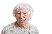 Elderly lady expressing negativity.