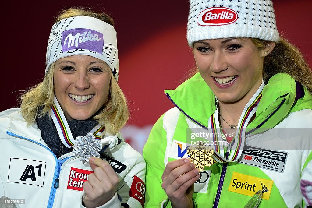 Silvers medallist Austria's Michaela Kirchgasser (L) and gold medallist US Mikaela Shiffrin pose during the medal awards ceremony after the women's slalom at the 2013 Ski World Championships in Schladming, Austria on February 16, 2013.