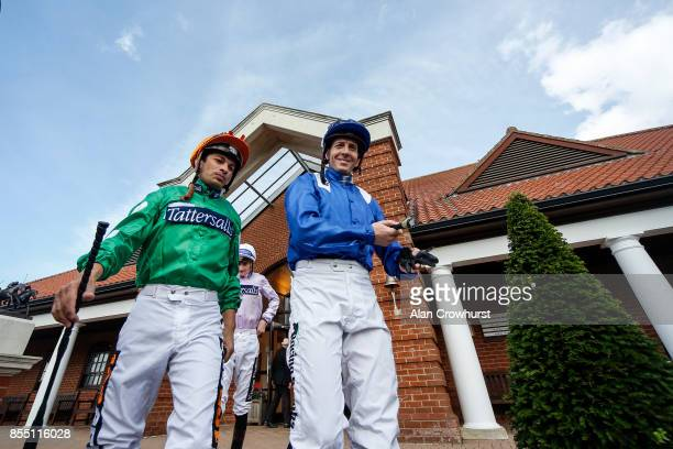 Silvestre De Sousa and Jim Crowley make their way to the parade ring at Newmarket racecourse on September 28 2017 in Newmarket United Kingdom