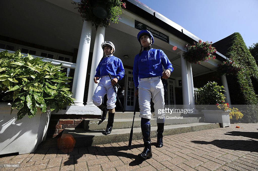 Silvestre De Sousa (L) and Mickael Barzalona in the colours of Godolphin at Sandown racecourse on August 31, 2013 in Esher, England.