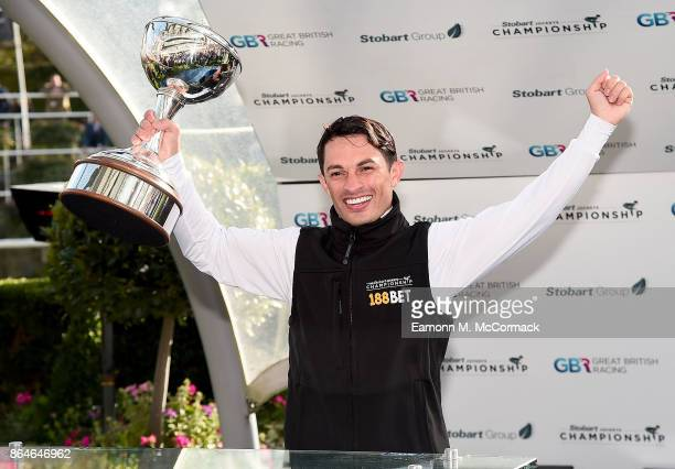 Silvestre De Sousa celebrates after being crowned Champion Jockey of the Season during the QIPCO British Champions Day at Ascot Racecourse on October...