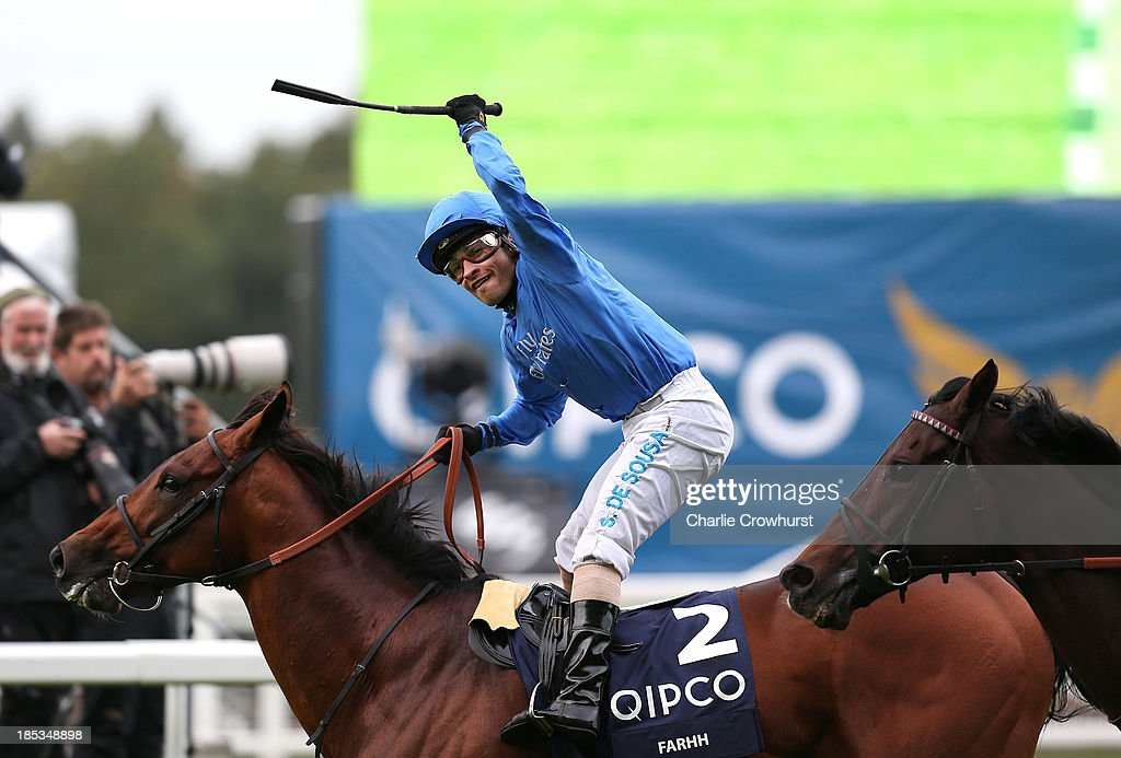 Silvestre De Sousa celebrates after he rides Farhh to win The QIPCO Champion Stakes beating Christophe Soumillion on Cirrus Des Aigles at Ascot racecourse on October 19, 2013 in Ascot, England.