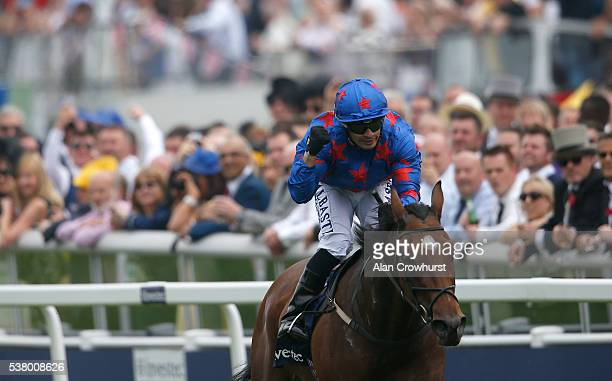 Silvestre De Sousa celebrates after riding Epsom Icon to win The Princess Elizabeth Stakes at Epsom Racecourse on June 4 2016 in Epsom England