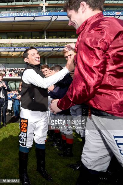 Silvestre De Sousa is congratulated after being crowned Champion Jockey during the QIPCO British Champions Day at Ascot Racecourse on October 21 2017...