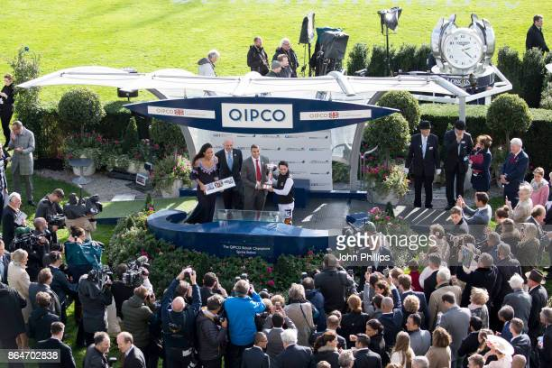 Silvestre De Sousa is presented with Champion Jockey of the Season by Adam Gemili during the QIPCO British Champions Day at Ascot Racecourse on...