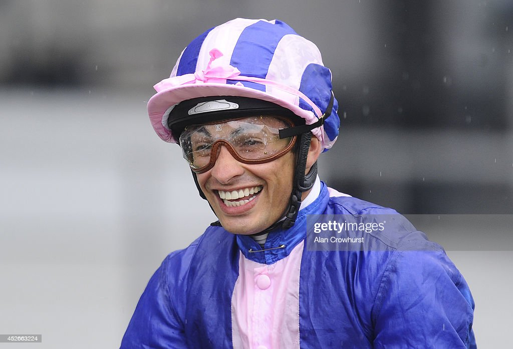 Silvestre De Sousa poses at Ascot racecourse on July 25, 2014 in Ascot, England.