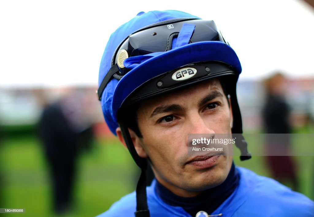 Silvestre De Sousa poses at Doncaster racecourse on September 13, 2013 in Doncaster, England.