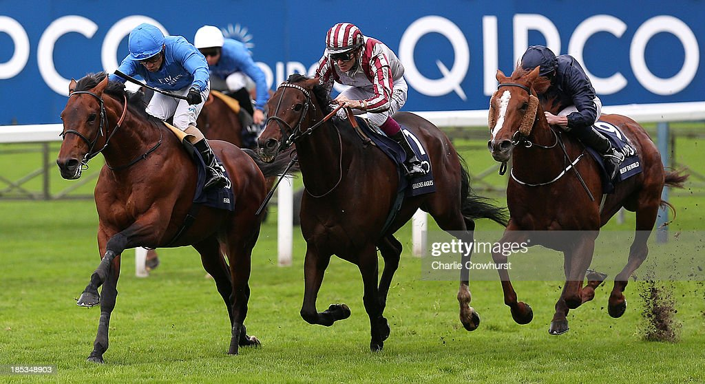 Silvestre De Sousa (3rd L) rides Farhh to win The QIPCO Champion Stakes beating Christophe Soumillion on Cirrus Des Aigles and Ruler of The World ridden by Ryan Moore at Ascot racecourse on October 19, 2013 in Ascot, England.
