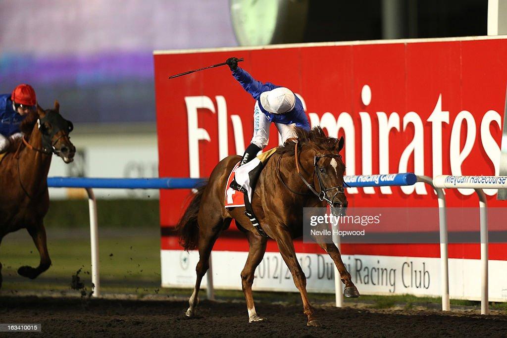 Silvestre De Sousa rides Hunter's Light (Blue Silks, white hat) in the 10f Group 1 Al Maktoum Challenge Round 3 race, during Super Saturday at Meydan Racecourse on March 9, 2013 in Dubai, United Arab Emirates.