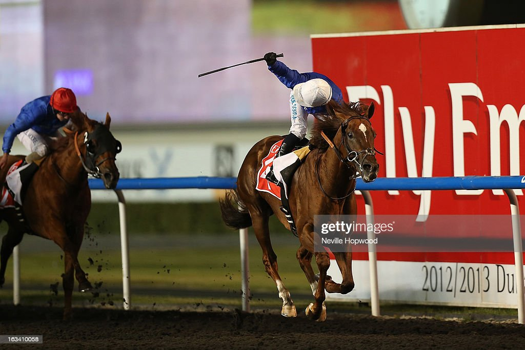 Silvestre De Sousa rides Hunter's Light (Blue Silks, white hat) in the 10f Group 1 Al Maktoum Challenge Round 3 race, during Super Saturday at Meydan Racecourse on March 9, 2013 in Dubai, United Arab Emirates.
