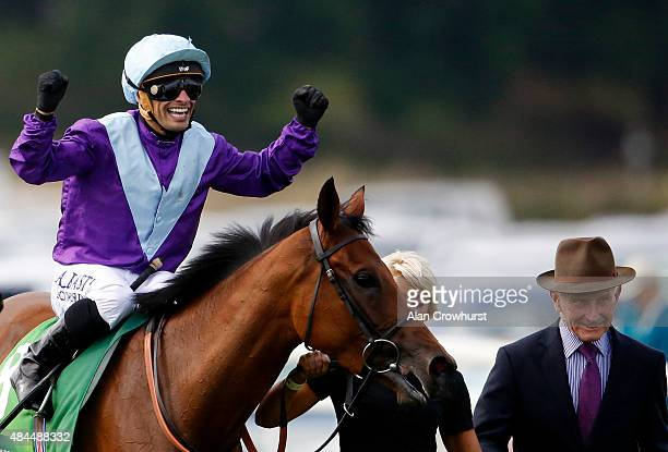 Silvestre De Sousa riding Arabian Queen celebrates winning The Juddmonte International Stakes at York racecourse on August 19 2015 in York England