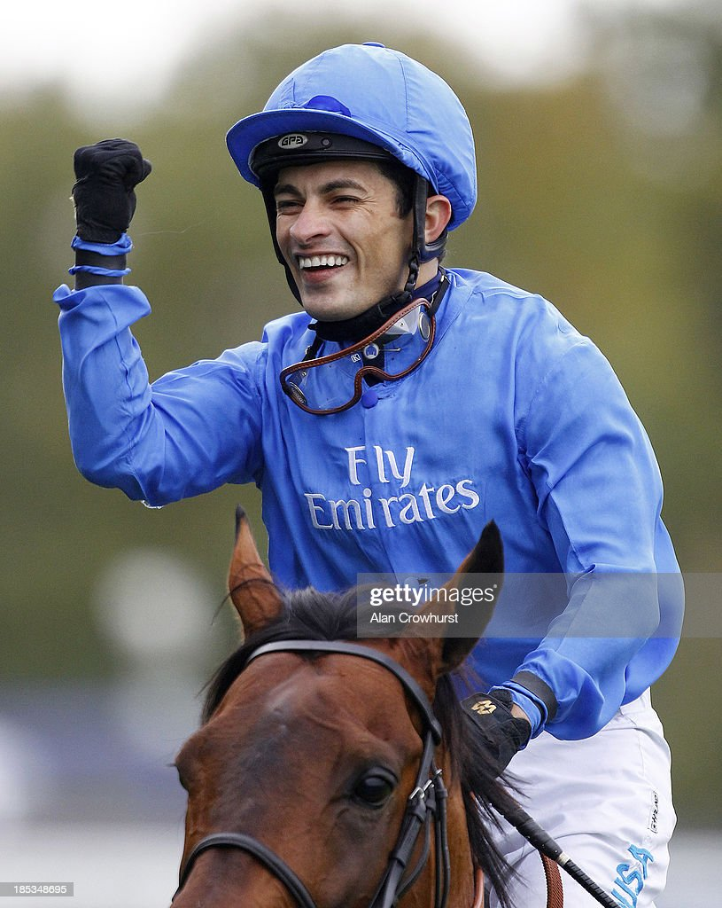 Silvestre De Sousa riding Farhh win The Qipco Champion Stakes at Ascot racecourse on October 19, 2013 in Ascot, England.