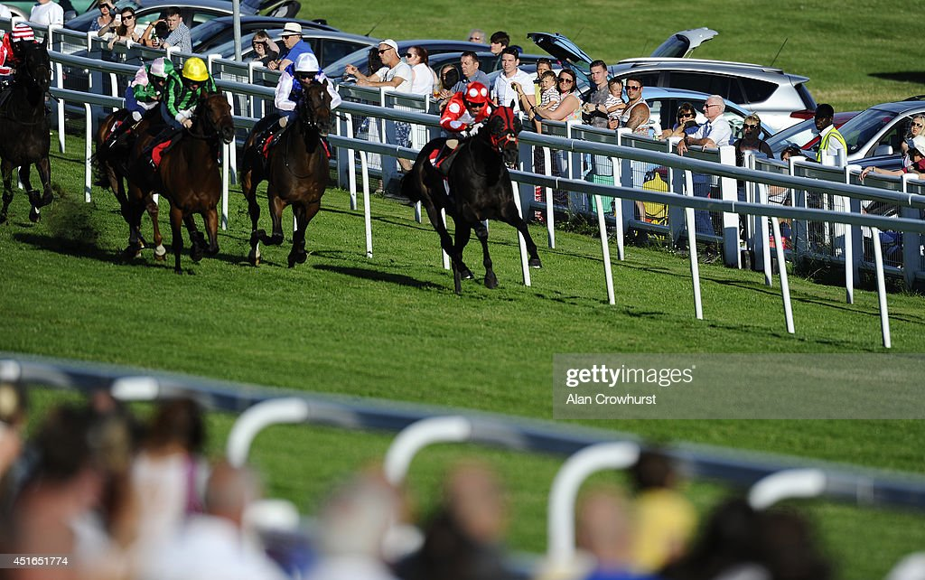 Silvestre De Sousa riding Swiss Cross (R) win The totepool Supporting The Sport You Love Handicap Stakes at Epsom racecourse on July 03, 2014 in Epsom, England.