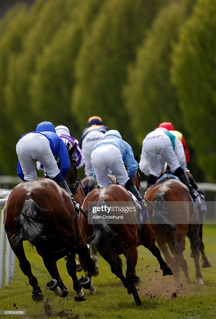 Silvestre De Sousa riding Viren's Army (R, sky blue) on their way to winning The Betdaq Dee Stakes at Chester racecourse on May 6, 2016 in Chester, England.