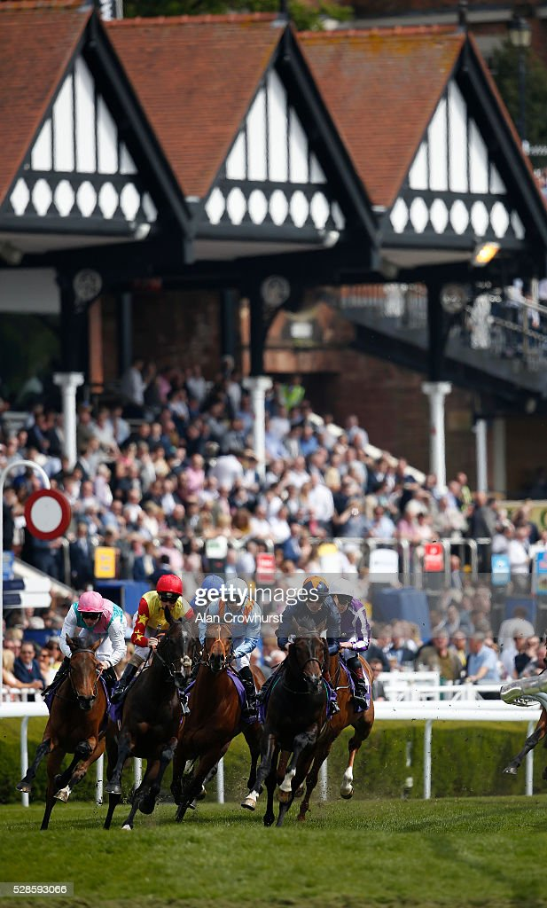 Silvestre De Sousa riding Viren's Army (C, sky blue) on their way to winning The Betdaq Dee Stakes at Chester racecourse on May 6, 2016 in Chester, England.