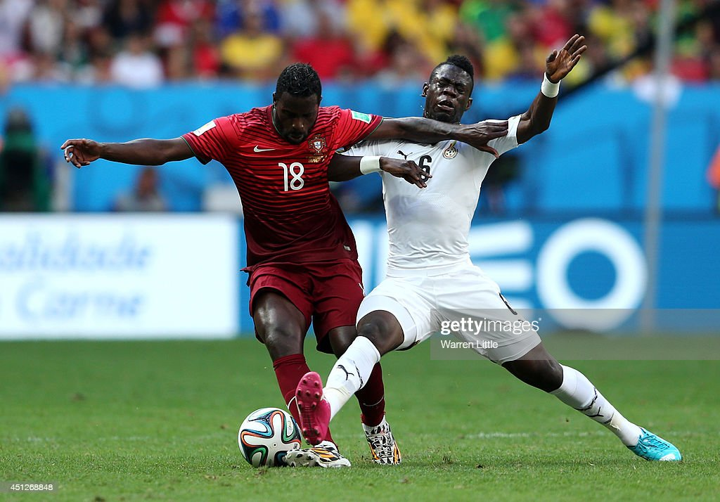 <a gi-track='captionPersonalityLinkClicked' href=/galleries/search?phrase=Silvestre+Varela&family=editorial&specificpeople=607288 ng-click='$event.stopPropagation()'>Silvestre Varela</a> of Portugal and Acquah Afriyie of Ghana compete for the ball during the 2014 FIFA World Cup Brazil Group G match between Portugal and Ghana at Estadio Nacional on June 26, 2014 in Brasilia, Brazil.