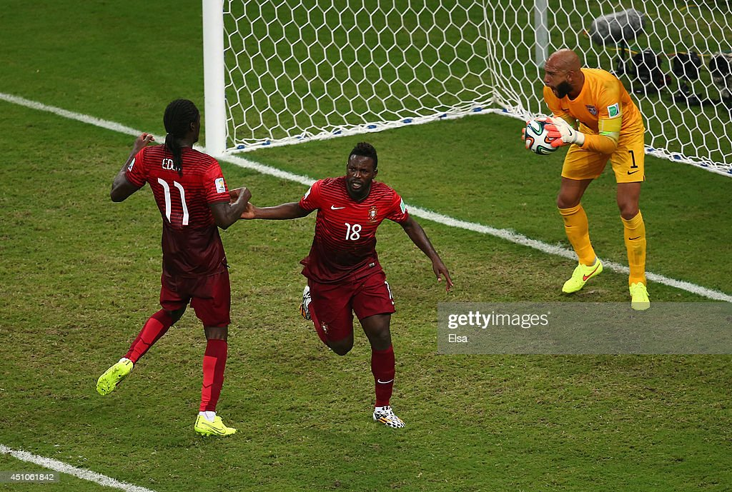 <a gi-track='captionPersonalityLinkClicked' href=/galleries/search?phrase=Silvestre+Varela&family=editorial&specificpeople=607288 ng-click='$event.stopPropagation()'>Silvestre Varela</a> of Portugal celebrates scoring his team's second goal as goalkeeper <a gi-track='captionPersonalityLinkClicked' href=/galleries/search?phrase=Tim+Howard+-+Soccer+Player&family=editorial&specificpeople=11515558 ng-click='$event.stopPropagation()'>Tim Howard</a> of the United States looks on during the 2014 FIFA World Cup Brazil Group G match between the United States and Portugal at Arena Amazonia on June 22, 2014 in Manaus, Brazil.