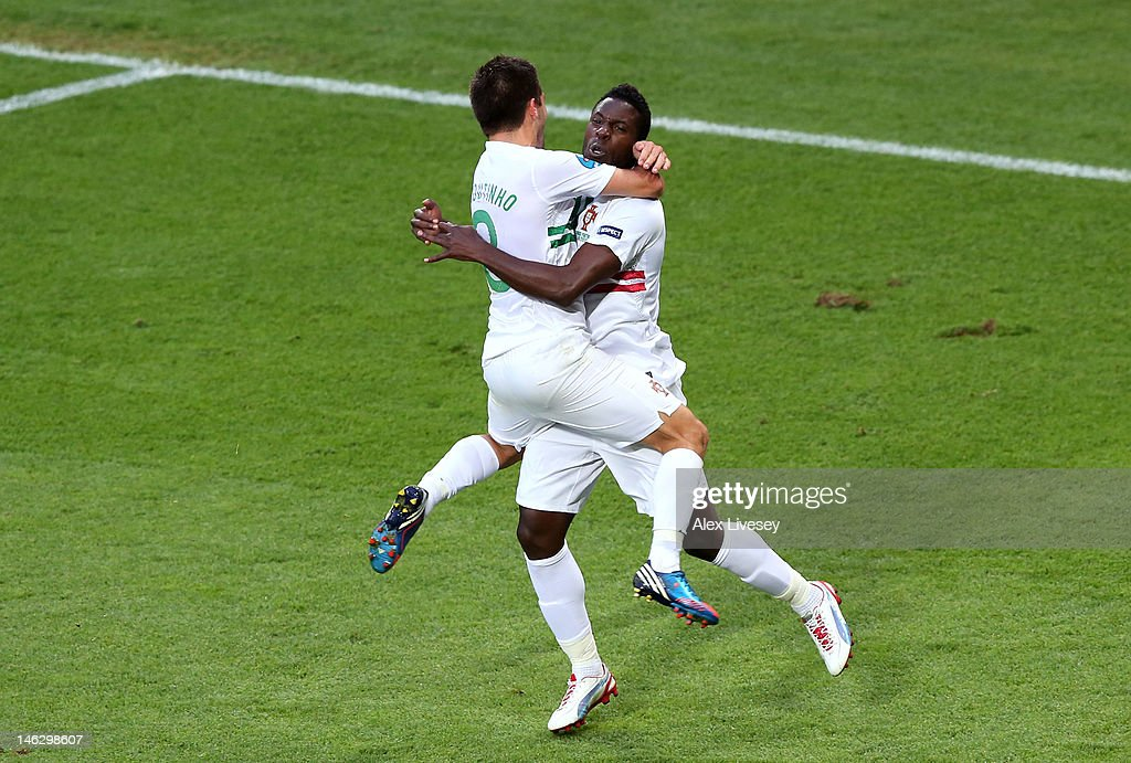 L'VIV, UKRAINE - JUNE 13: Silvestre Varela of Portugal celebrates scoring their third goal with Joao Moutinho of Portugal during the UEFA EURO 2012 group B match between Denmark and Portugal at Arena Lviv on June 13, 2012 in L'viv, Ukraine.