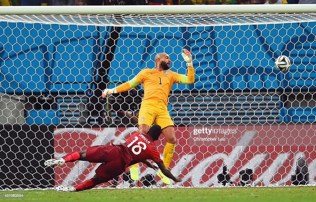<a gi-track='captionPersonalityLinkClicked' href=/galleries/search?phrase=Silvestre+Varela&family=editorial&specificpeople=607288 ng-click='$event.stopPropagation()'>Silvestre Varela</a> of Portugal scores his team's second goal as goalkeeper <a gi-track='captionPersonalityLinkClicked' href=/galleries/search?phrase=Tim+Howard+-+Soccer+Player&family=editorial&specificpeople=11515558 ng-click='$event.stopPropagation()'>Tim Howard</a> of the United States looks on during the 2014 FIFA World Cup Brazil Group G match between the United States and Portugal at Arena Amazonia on June 22, 2014 in Manaus, Brazil.