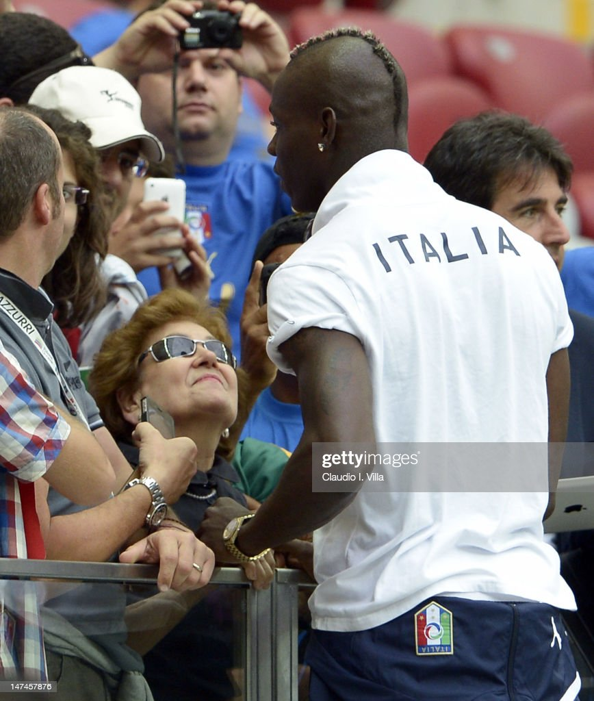 (L-R) Silvia Balotelli and Mario Balotelli of Italyduring the UEFA EURO 2012 semi final match between Germany and Italy at National Stadium on June 28, 2012 in Warsaw, Poland.
