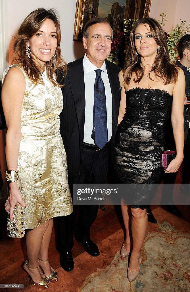 (L to R) Silvia Bruttini, Ambassador Alain Giorgio Maria Economides and Elizabeth Hurley attend a dinner celebrating the launch of 'Valentino: Master Of Couture', the new exhibition showing at Somerset House from November 29, 2012 to March 3, 2013, at the Italian Embassy on November 28, 2012 in London, England.