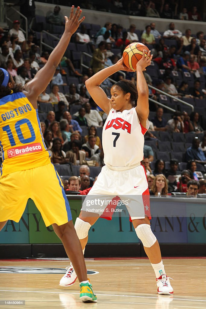 Silvia Cristina Gustavo Rocha Valente #10 of the Brazilian Women's Senior National Team guards <a gi-track='captionPersonalityLinkClicked' href=/galleries/search?phrase=Maya+Moore+-+Basketball+Player&family=editorial&specificpeople=4215914 ng-click='$event.stopPropagation()'>Maya Moore</a> #7 of the 2012 US Women's Senior National Team during a game at the Verizon Center on July 16, 2012 in Washington, DC.