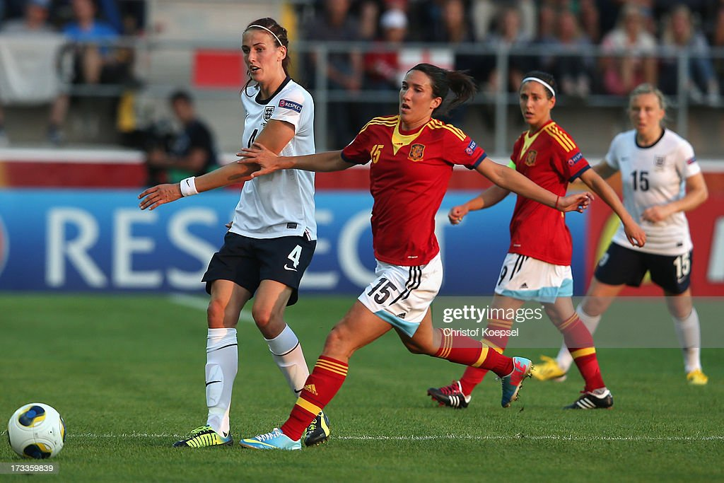 Silvia Meseguer of Spain (2nd L) challenges Jill Scott of England (L) during the UEFA Women's EURO 2013 Group C match between England and Spain at Linkoping Arena on July 12, 2013 in Linkoping, Sweden.
