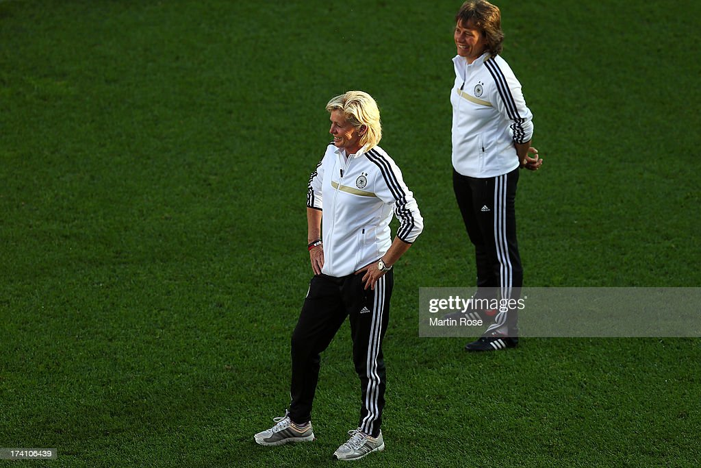 <a gi-track='captionPersonalityLinkClicked' href=/galleries/search?phrase=Silvia+Neid&family=editorial&specificpeople=641230 ng-click='$event.stopPropagation()'>Silvia Neid</a>, head coach of Germany looks on during the training session of Germany at Vaxjo Arena on July 20, 2013 in Vaxjo, Sweden.