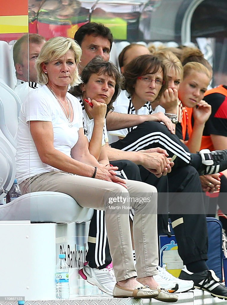 Silvia Neid (L), head coach of Germany looks on during the Women's International Friendly match between Germany and Canada at Benteler Arena on June 19, 2013 in Paderborn, Germany.