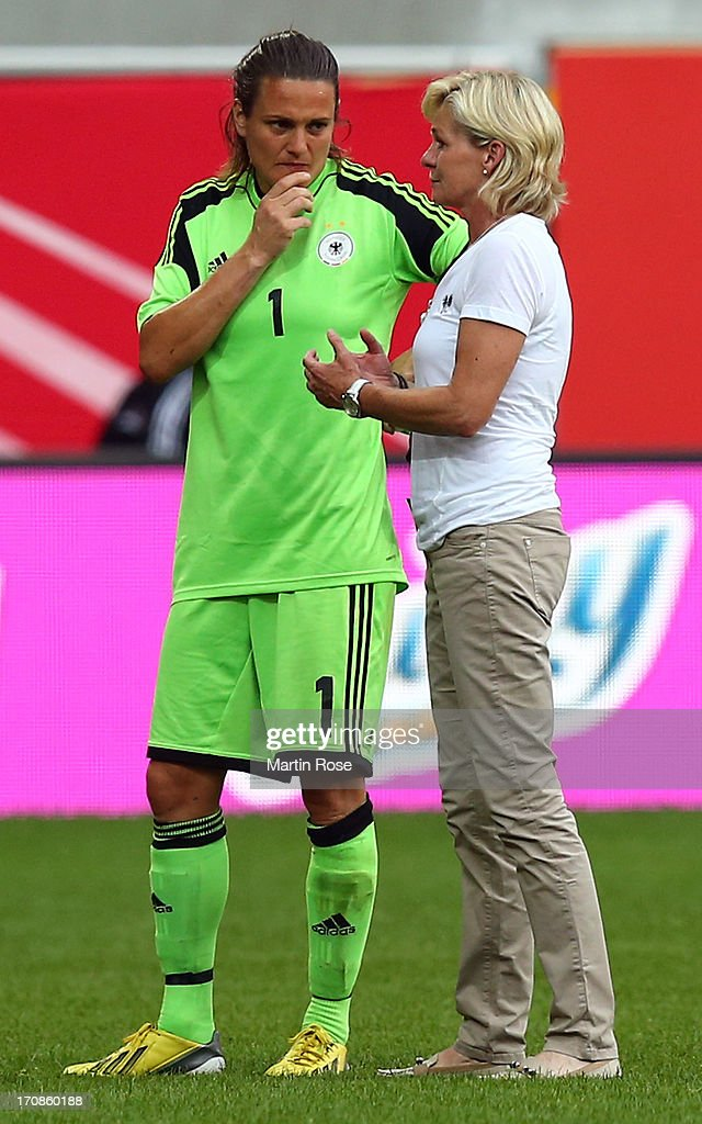 Silvia Neid (R), head coach of Germany speaks to Nadine Angerer, goalkeeper of Germany after the Women's International Friendly match between Germany and Canada at Benteler Arena on June 19, 2013 in Paderborn, Germany.