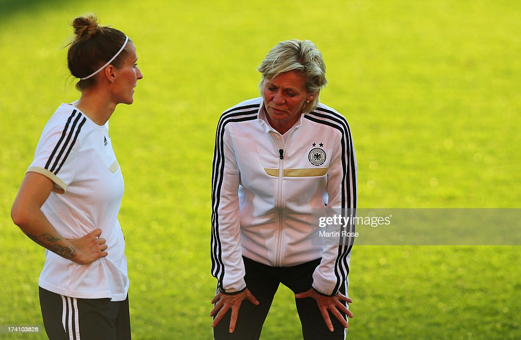 <a gi-track='captionPersonalityLinkClicked' href=/galleries/search?phrase=Silvia+Neid&family=editorial&specificpeople=641230 ng-click='$event.stopPropagation()'>Silvia Neid</a> (R), head coach of Germany talks to <a gi-track='captionPersonalityLinkClicked' href=/galleries/search?phrase=Anja+Mittag&family=editorial&specificpeople=210615 ng-click='$event.stopPropagation()'>Anja Mittag</a> during the training session of Germany at Vaxjo Arena on July 20, 2013 in Vaxjo, Sweden.