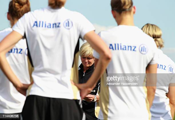 Silvia Neid head coach of team Germany gives instructions to her players during a training session of the German national woman team at the adidas...