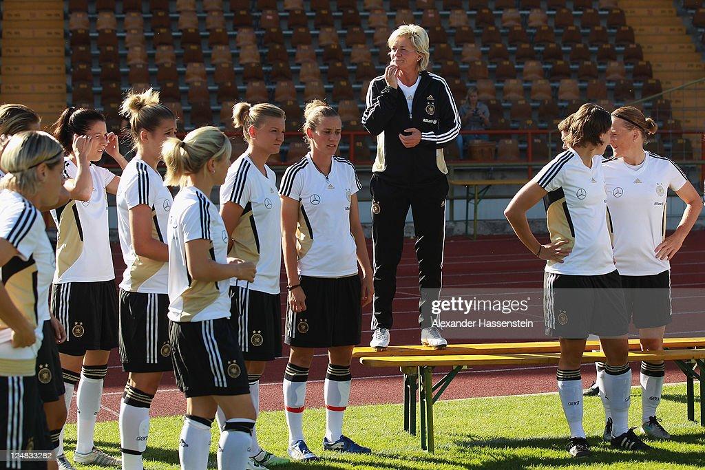 Silvia Neid (C), head coach of team Germany looks on prior to the team presentation of the German Women's national team at Rosenau Stadium on September 13, 2011 in Augsburg, Germany.