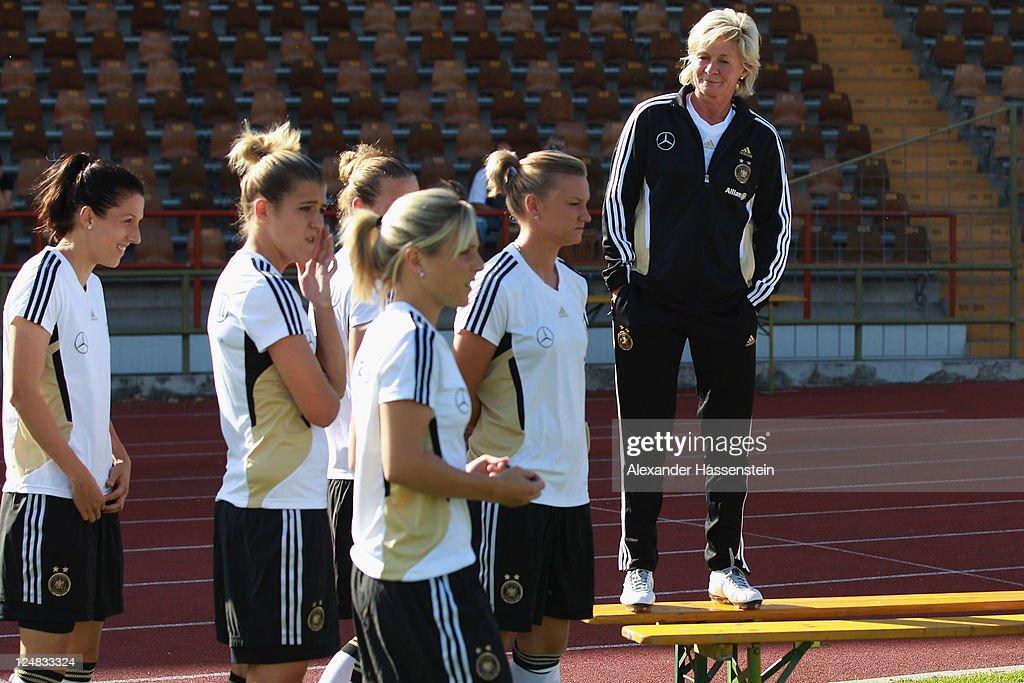 Silvia Neid (R), head coach of team Germany looks on prior to the team presentation of the German Women's national team at Rosenau Stadium on September 13, 2011 in Augsburg, Germany.