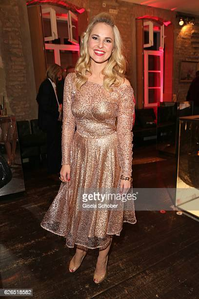 Silvia Schneider wearing a golden dress by Lena Hoschek during the New Faces Award Style 2016 at 'The Grand' on November 16 2016 in Berlin Germany