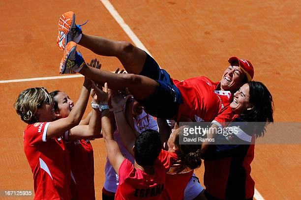Silvia Soler of Spain is tossed by her teammates after Carla Suarez of Spain won her match against Ayumi Morita of Japan during the day two of the...