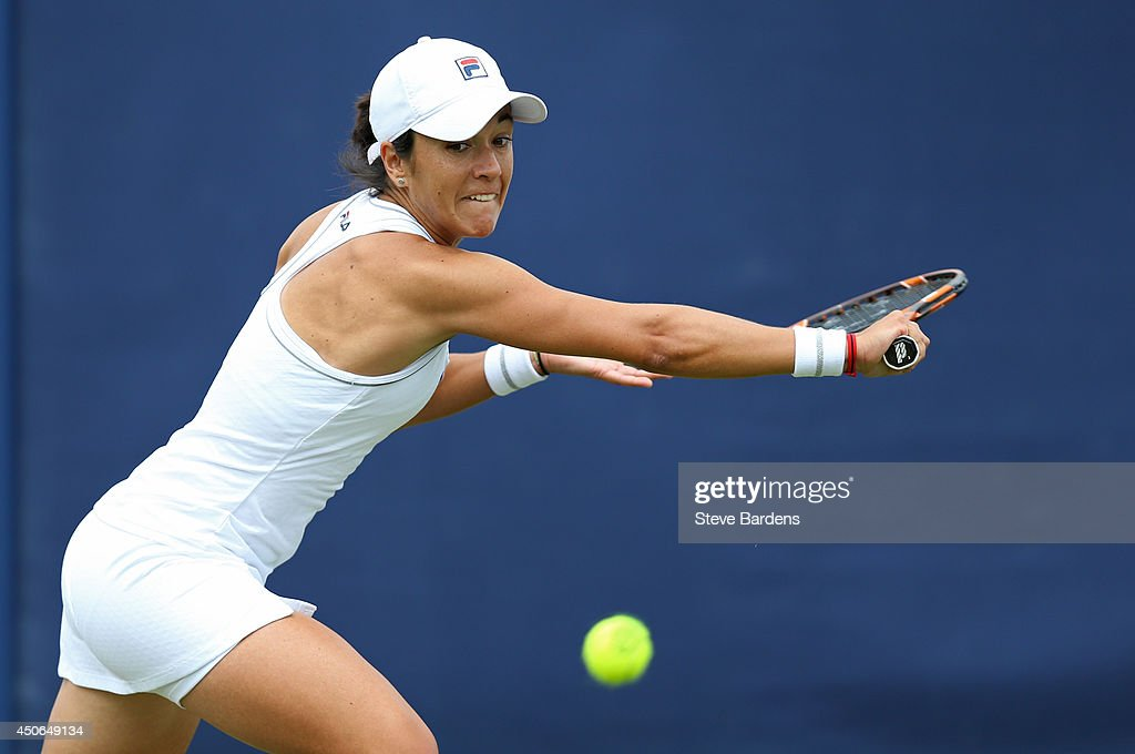Silvia Soler-Espinosa of Spain plays a backhand against Luksika Kumkhum of Thailand during their third round qualification match on day two of the Aegon International at Devonshire Park on June 15, 2014 in Eastbourne, England.