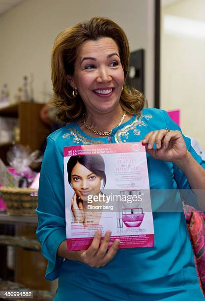 Silvia Tamayo a senior executive unit leader for Avon Products Inc holds a flyer while leading a sales meeting in McAllen Texas US on Thursday Aug 28...
