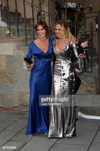 Silvia Toffanin and Ilary Blasi attend the Michelle Hunziker Wedding With Tomaso Trussardi at Palazzo della Ragione on October 10 2014 in Bergamo...