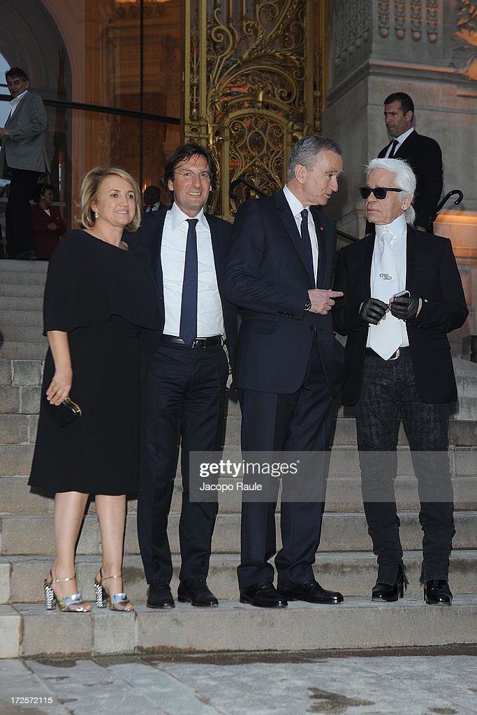 Silvia Venturini Fendi, Pietro Beccari, Bernard Arnault and Karl Lagerfeld arrives at 'The Glory Of Water' : Karl Lagerfeld's Exhibition Dinner at Fendi on July 3, 2013 in Paris, France.