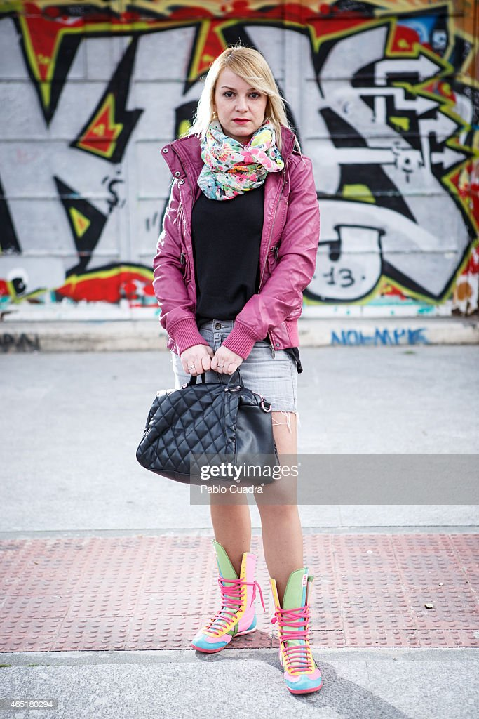 Silvia wears Bershka jacket Zara handbag Mango pullover and skirt and Munich boots on March 3 2015 in Madrid Spain