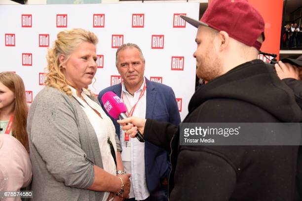Silvia Wollny and her boyfriend Harald Elsenbast attend the 'BILD Renntag' at Trabrennbahn on May 1 2017 in Gelsenkirchen Germany