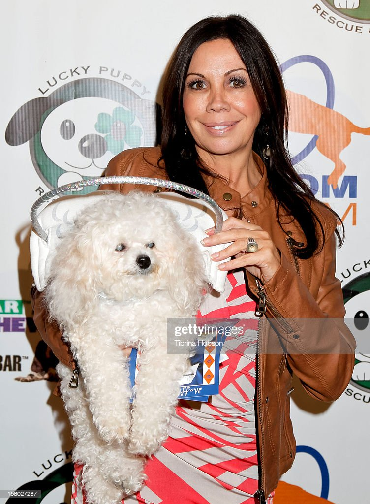 Silvie Bordeaux and Muffin Bordeaux attend the Lucky Puppy Rescue and Retail grand opening on December 8, 2012 at Lucky Puppy Rescue in Studio City, California.