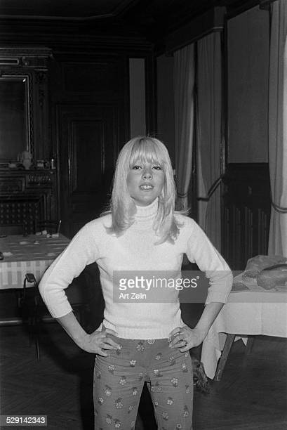 Silvie Vartan wearing a sweater and flowered pants circa 1970 New York