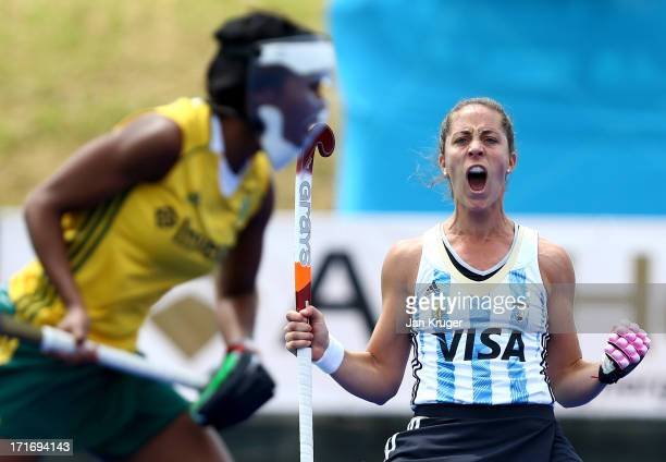 Silvina D'Elia of Argentina celebrates the opening goal during the Investec Hockey World League quarterfinal match between Argentina and South Africa...