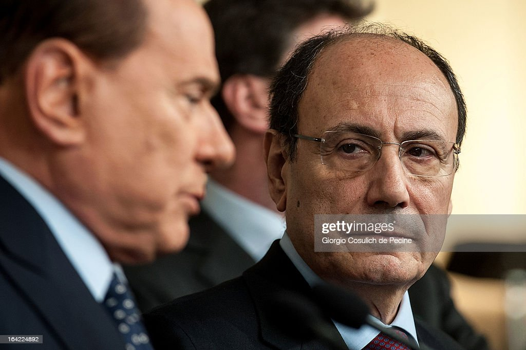 <a gi-track='captionPersonalityLinkClicked' href=/galleries/search?phrase=Silvio+Berlusconi&family=editorial&specificpeople=201842 ng-click='$event.stopPropagation()'>Silvio Berlusconi</a> (L) and former president of the Senate, <a gi-track='captionPersonalityLinkClicked' href=/galleries/search?phrase=Renato+Schifani&family=editorial&specificpeople=4851265 ng-click='$event.stopPropagation()'>Renato Schifani</a>, attend a press statement after a meeting with Italian President Giorgio Napolitano at the Quirinale Palace on March 21, 2013 in Rome, Italy. The president of the Italian Republic, Giorgio Napolitano began two days of consultations with political parties to identify the potential prime minister able to form a new government that can win the confidence of the majority in the Parliament.